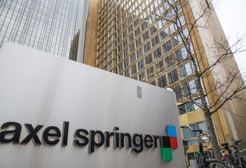 (FILES) This file photo taken on March 9, 2017 shows the headquarters of German media group Axel Springer in Berlin. German publisher Axel Springer signed a deal to acquire the US-based news organization Politico, along with the remaining shares of their Politico Europe joint venture, the companies announced on August 26, 2021. (Photo by Odd ANDERSEN / AFP)