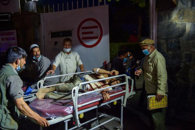 One person was injured on a stretcher in Kabul on August 26, 2021.