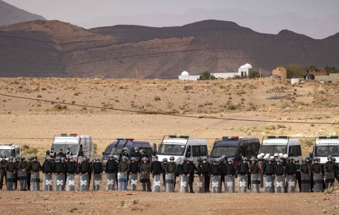 Moroccan security forces stand guard during a demonstration by Moroccan farmers in Figueroa (eastern Morocco) after they were expelled from Algerian territory on March 18.