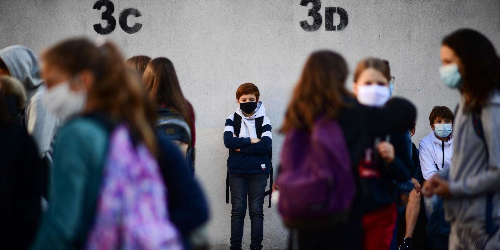(FILES) In this file photograph taken on September 1, 2020, pupils wearing protective masks stand at Françoise-Giroud middle school in Vincennes, east of Paris, on the first day of the school year amidst the Covid-19 epidemic. In a statement issued on August 26, 2021, France's Education Minister Jean-Michel Blanquer said he hoped the start of the 2021-2022 school year scheduled for September 2, 2021, would be
