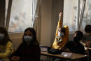 FILE - In this Sept. 2, 2021, file photo, children sit in a classroom at school in Strasbourg, eastern France. In France face coverings must be worn by pupils 6 and up, and whole primary school classes will be sent home if one child tests positive. (AP Photo/Jean-François Badias, File)