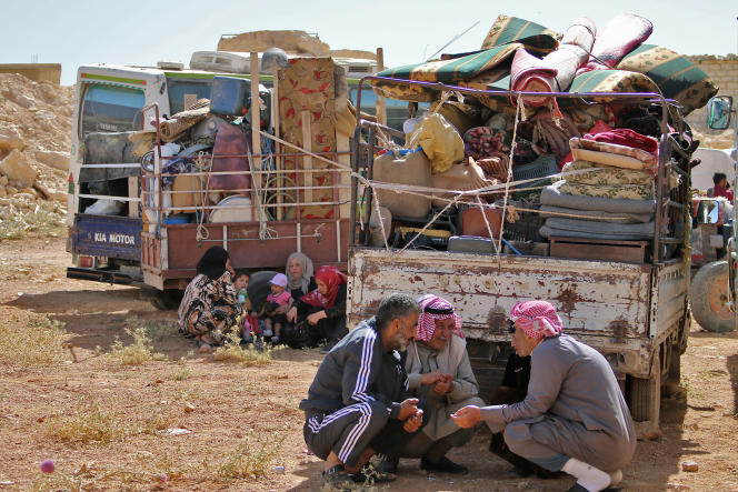 Syrian refugees prepare to return to Syria from the border town of Arsal, Lebanon, in June 2018.