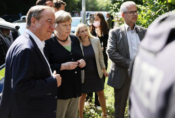 Armin Laschet and Angela Merkel visiting one of the flood affected regions in Hagen, Germany on September 5, 2021.