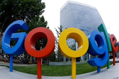 FILE PHOTO: The brand logo of Alphabet Inc's Google is seen outside its office in Beijing, China August 8, 2018. Picture taken with a fisheye lens. REUTERS/Thomas Peter/File Photo