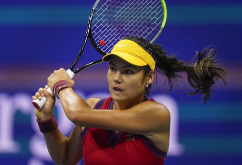 Emma Raducanu, of Great Britain, returns a shot to Maria Sakkari, of Greece, during the semifinals of the US Open tennis championships, Thursday, Sept. 9, 2021, in New York. (AP Photo/Frank Franklin II)