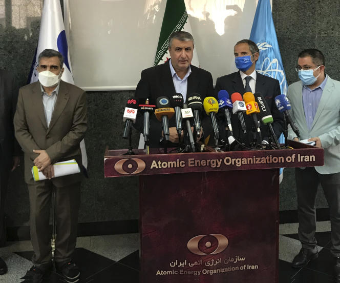 The director of the Iranian Atomic Energy Agency, Mohammad Eslami (center), in Tehran, September 12, 2021.