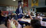 French President Emmanuel Macron poses in a classroom during a visit at Bouge primary school in Malpasse district of Marseille, France, September 2, 2021, as twelve million children went back to school on Thursday for the new academic year, wearing face masks as part of rules aimed at slowing down the spreading of COVID-19 in the country. Daniel Cole/Pool via REUTERS