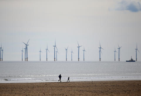 Teesside Offshore Windfarm, operated by EDF Energy, is pictured off of the cost of Hartlepool in north east England on May 3, 2021. (Photo by Lindsey Parnaby / AFP)