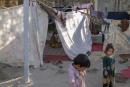 Des déplacés ayant fuit les combats et vivant dans des tentes dans le parc Shahr-e Naw dans le centre de Kaboul, le 14 septembre. Par manque de moyens ils ne peuvent retourner dans leur village.