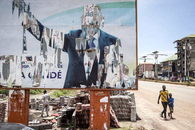 A dilapidated poster of former Guinean President Alpha Condé, in Conakry, September 16, 2021.