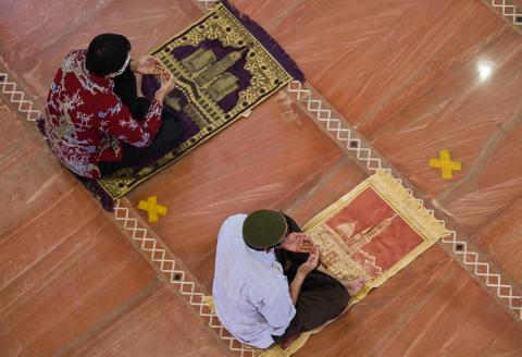 Muslims attend Friday prayers with social distancing measures in place due to the Covid-19 pandemic at the Golden Dome mosque in Depok, West Java on September 17, 2021. (Photo by ADEK BERRY / AFP)