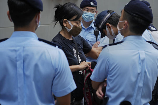 Activist Chen Baoying arrested by police during protests against the election of the committee called to elect the next Hong Kong leader, in Hong Kong on September 19, 2021.