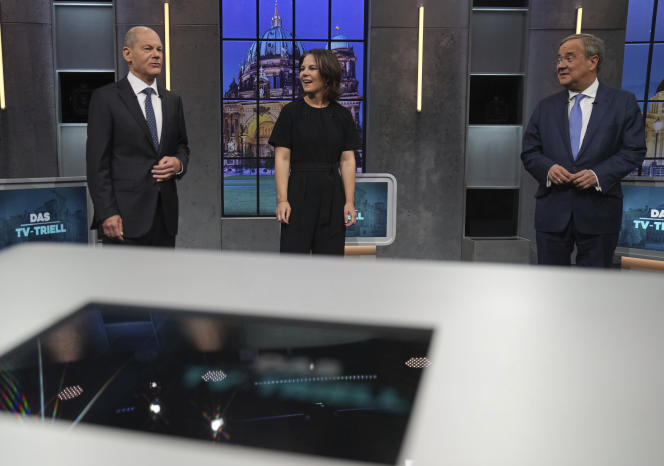 Chancellor candidates Olaf Scholz (SPD), Annalena Baerbock (Greens) and Armin Laschet (CDU-CSU) on the stage of the debate organized by the channels Sat 1 and Kabel Eins, on September 26, in Berlin.