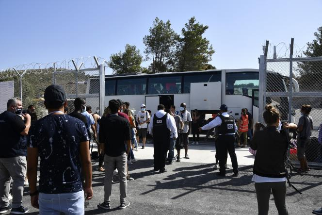 Security personnel screen migrants as they arrive at the new, closed guarded facility in the village of Zervou, on the eastern Aegean island of Samos, Greece, on September 20, 2021.