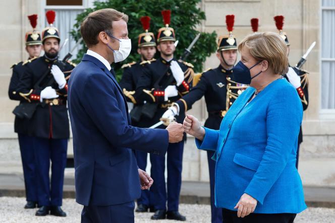 Le président Emmanuel Macron et la chancelière allemande, Angela Merkel lors d'un dîner à l'Elysée, le 16 septembre 2021.