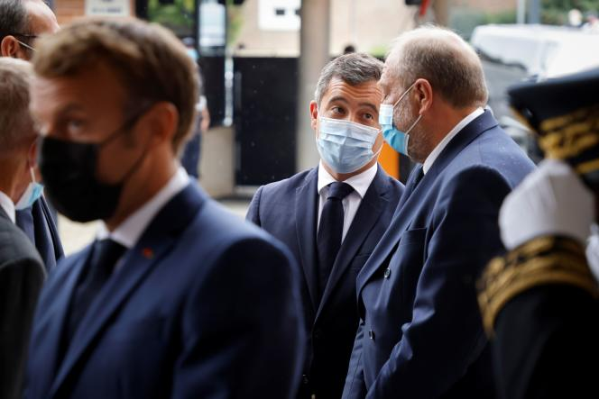 Interior Minister Gérald Darmanin speaks with Justice Minister Eric Dupond-Moretti during a visit by President Emmanuel Macron to the Roubaix police academy, September 14, 2021.