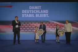 Markus Söder, Armin Laschet and Angela Merkel lors du dernier meeting de campagne CDU-CSU, à Munich, le 24 septembre 2021.