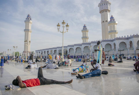 Pilgrims lie down in the Great Mosque of Touba during the Grand Magal of Mourides in Touba on September 26, 2021, the largest annual muslim pilgrimage in Senegal, with hundreds of thousands making the pilgrimage each year. (Photo by CARMEN ABD ALI / AFP)