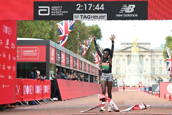 Joycelyn Jepkosgei of Kenya crosses the finish line of the London Marathon, UK, on Sunday October 3, 2021.