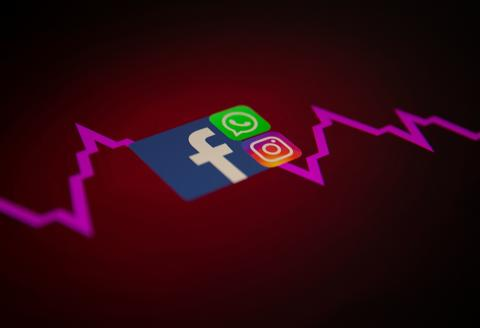 Facebook, Whatsapp and Instagram logos and stock graph are seen displayed in this illustration taken October 4, 2021. REUTERS/Dado Ruvic/Illustration