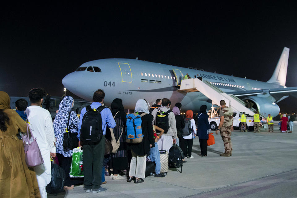 Handout photo of Afghan refugees boarding a French Air Force Airbus aircraft at an air base in United Arab Emirates on August 23, 2021. Photo by Etat Major des Armees via ABC/Andia.fr