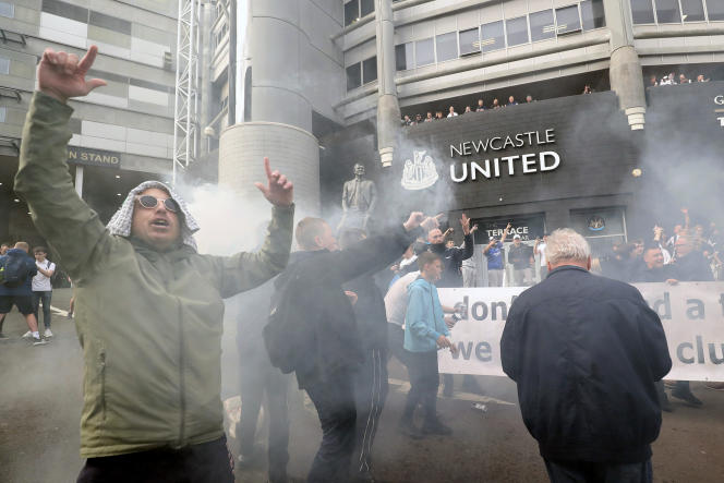 Newcastle United supporters celebrate the club's purchase announcement outside Newcastle Stadium on October 7, 2021.