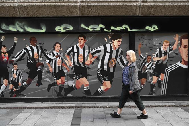 In front of a mural in tribute to Newcastle United players, in Newcastle, on October 8.
