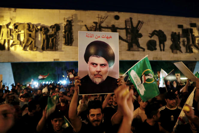 Supporters of Moqtada Al-Sadr celebrate, in Tahrir Square in Baghdad, on October 11, 2021, the victory of the Shiite leader's movement in the legislative elections.