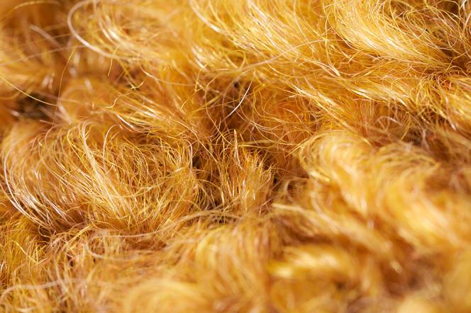 Tissu en laine bouclette (laine, mohair et alpaga) servant au spécialiste du textile d'ameublement Pierre Frey.