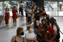 Members of the public queue to receive the Pfizer-BioNTech Covid-19 vaccine in the Turbine Hall at a temporary Covid-19 vaccine centre at the Tate Modern in central London on July 16, 2021. (Photo by Tolga Akmen / AFP)
