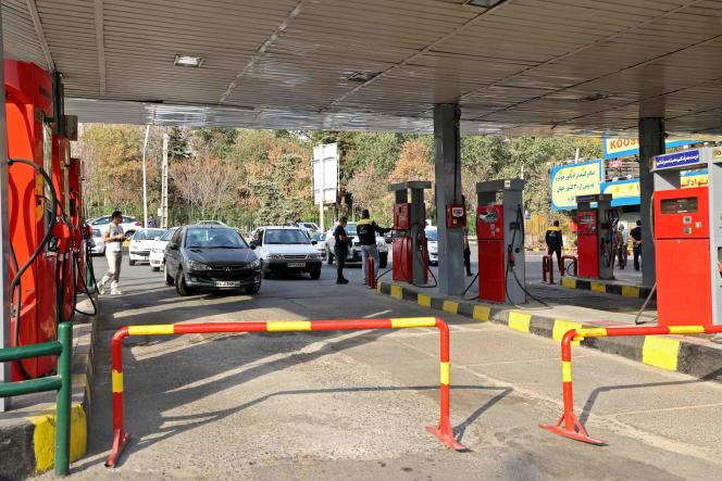 Cars line up outside a gas station as gasoline distribution is suspended across Iran after a cyberattack on October 26, 2021.