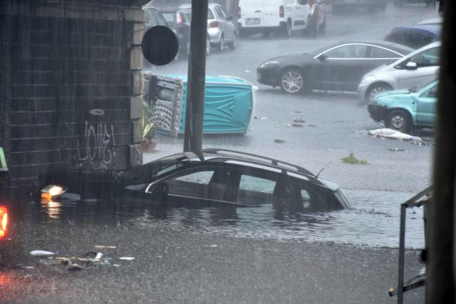 A submerged car after torrential rains, in Catania (Italy), October 26, 2021.