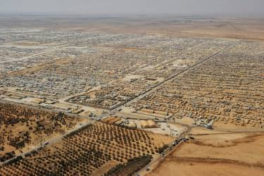 An aerial view shows the Zaatari refugee camp in Mafraq, Jordan, Thursday, July 18, 2013. Angry Syrian refugees urged U.S. Secretary of State John Kerry on Thursday to do more to help opponents of President Bashar Assad's government, venting frustration at perceived inaction on their behalf. (AP Photo/Mandel Ngan, Pool)