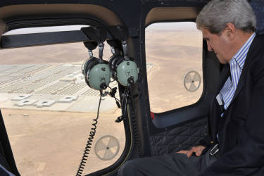 U.S. Secretary of State John Kerry looks out of a helicopter's window at Zaatari refugee camp, while flying to the camp, near Mafraq July 18, 2013. Kerry spent about 40 minutes with half a dozen refugees who vented their frustration at the international community's failure to end Syria's more than two-year-old civil war, while visiting a camp that holds roughly 115,000 Syrian refugees in Jordan about 12 km (eight miles) from the Syrian border. REUTERS/Mandel Ngan/Pool (JORDAN - Tags: POLITICS)