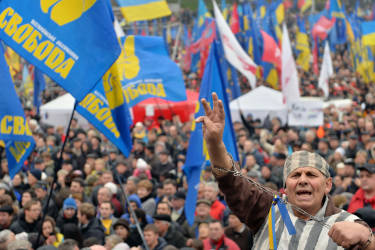 Protestors shout slogans during a rally in Kiev on November 24, 2013. Pro-West Ukrainians on November 24 staged the biggest protest in Kiev since the 2004 Orange Revolution, demanding that the government sign a key pact with the European Union and clashing with police. The opposition called the rally after President Viktor Yanukovych's government reversed a plan to sign a historic deal deepening ties with the European Union, in a U-turn critics said was forced by the Kremlin. AFP PHOTO/SERGEI SUPINSKY