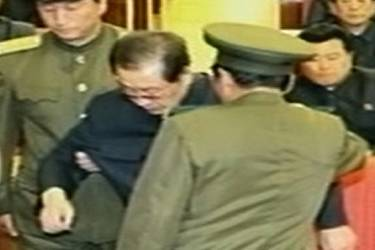 This undated image grab taken from footage shown by North Korea's KCTV and released by South Korea's Yonhap news agency on December 9, 2013, shows Jang Song-Thaek (C) reportedly being dragged out from his chair by two police officials during a meeting in Pyongyang. North Korea confirmed on December 9 that the powerful uncle of young leader Kim Jong-Un has been purged, with state TV airing humiliating images of Jang Song-Thaek being dragged away by uniformed officers.  REPUBLIC OF KOREA OUT  NO ARCHIVES  NO INTERNET    RESTRICTED TO SUBSCRIPTION USE     AFP PHOTO/YONHAP