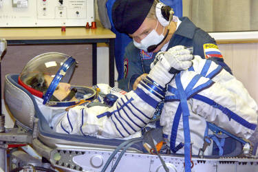A member of Russia's Souyz TMA-9 space vessel crew, US entrepreneur Anousheh Ansari, the first female space tourist sits in a special lodgement for the space-suit containment control in the assembly-experimental department of Baikonur cosmodrome, 04 September 2006. The flight of the world's first female space tourist to the International Space Station (ISS) will be put off by four days and scheduled on 18 September because of delays in launching the US space shuttle. AFP PHOTO / STRINGER
