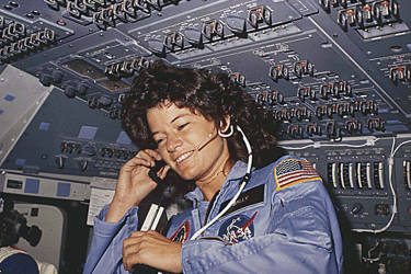 This NASA file photo taken 18-24 June 1983  shows America's first woman astronaut Sally Ride, as she communicates with ground controllers from the flight deck during the six day space mission of the Challenger. AFP PHOTO/NASA
