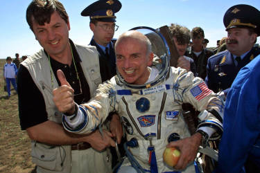 US space tourist Dennis Tito celebrates after his landing near the Kazakh town of Arkalyk (some 300 km from Astana), 06 May 2001. The world's first-ever space tourist Dennis Tito hailed a trip to Paradise after the US millionaire and two Russian cosmonauts successfully landed back on earth. AFP PHOTO/ ALEXANDER NEMENOV.