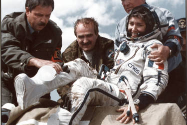 France's first female astronaut Claudie Andre-Deshays is helped out get out of the just-landed Russian capsule some 200 km from Karaganda, 02 September 1996. Andre-Deshays spent 14 days of her 16-day adventure aboard the Russian orbiting Mir space station conducting a series of medical, biological, physical and technological experiments prepared by some 40 French laboratories and industrial organisations.