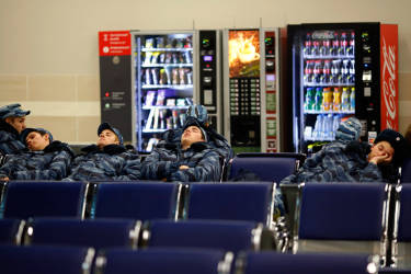 Members of Russia's security forces rest inside the train station of Krasnaya Polyana near Sochi, January 29, 2014. Sochi will host the 2014 Winter Olympic Games from February 7 to February 23. REUTERS/Kai Pfaffenbach (RUSSIA - Tags: SOCIETY SPORT OLYMPICS)