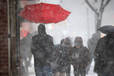 NEW YORK, NY - FEBRUARY 13: A person walks with an upturned umbrella during a snowstorm on February 13, 2014 in New York City. Heavy snow and high winds made for a hard morning commute in the city.   John Moore/Getty Images/AFP== FOR NEWSPAPERS, INTERNET, TELCOS & TELEVISION USE ONLY ==