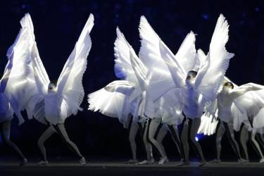 Performers dance during the closing ceremony of the 2014 Winter Olympics, Sunday, Feb. 23, 2014, in Sochi, Russia. (AP Photo/Matt Dunham)