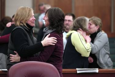 PONTIAC, MI - MARCH 22: Same-sex couples get married in a group ceremony at the Oakland County Courthouse on March 22, 2014 in Pontiac, Michigan. A Federal judge overturned Michigan's ban on same-sex marriage on Friday, March 21, 2014.   Bill Pugliano/Getty Images/AFP== FOR NEWSPAPERS, INTERNET, TELCOS & TELEVISION USE ONLY ==