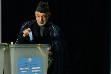Afghan President Hamid Karzai casta his vote at a local polling station in Kabul on April 5, 2014. Afghan voters went to the polls to choose a successor to President Hamid Karzai, braving Taliban threats in a landmark election held as US-led forces wind down their long intervention in the country. Afghanistan's third presidential election brings an end to 13 years of rule by Karzai, who has held power since the Taliban were ousted in a US-led invasion in 2001, and will be the first democratic handover of power in the country's turbulent history.   TOPSHOTS/AFP PHOTO/Wakil KOHSAR