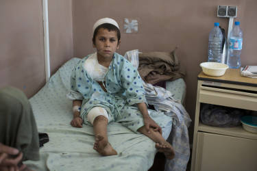 March 30, 2014 - Kandahar, Afghanistan - Mirwais Hospital sponsored by the Red Cross.A young boy recovers after being wounded in an air strike that his father says was conducted by drones.