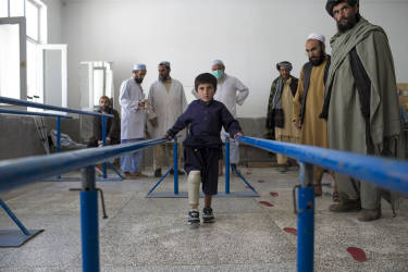 March 30, 2014 - Kandahar, Afghanistan - Mirwais Hospital sponsored by the Red Cross.A young boy tries a few steps on a new prosthetic leg fitted in the orthopedic ward.