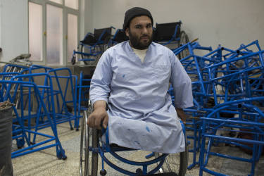 March 30, 2014 - Kandahar, Afghanistan - Mirwais Hospital sponsored by the Red Cross.An amputee employee organizes wheelchair components manufactured on site.