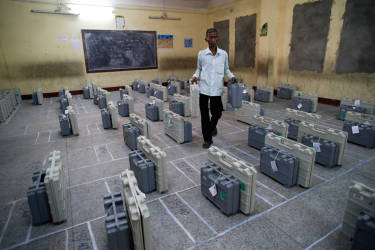 An election official carries electronic voting machines to be handed over to poll officials before they leave for their designated polling booths in Agartala, in the north-eastern Indian state of Tripura, India, Sunday, April 6, 2014. The first phase of several weeks long national elections will be underway when parts of the eastern Indian states of Tripura and Assam go to poll on Monday, April 7. (AP Photo/Saurabh Das)