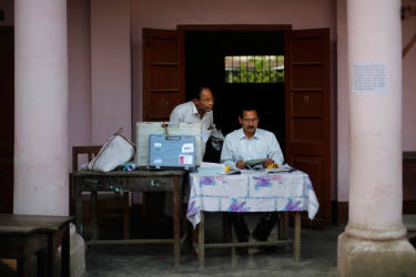 Indian election officials work to setup a polling station inside a school on the eve of the first phase of national elections in Dibrugarh, in the northeastern state of Assam, India, Sunday, April 6, 2014. India will hold national elections from April 7 to May 12, kicking off a vote that many observers see as the most important election in more than 30 years in the world's largest democracy. (AP Photo/Altaf Qadri)
